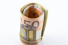 Euro cincuenta rodado para arriba en el fondo blanco Imagen de archivo