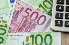 500 euro close up, 100 euro and calculator. Close-up. 500 euro close up, 100 euro and calculator stock photos