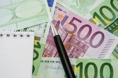 500 euro closeup, pen, part of notepad and euro banknote. 500 euro , pen, part of notepad and euro banknote royalty free stock photos