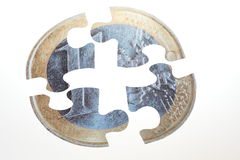 Euro coin. Currency Puzzle - Split Pie euro coin with white background Royalty Free Stock Images