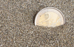 Euro coin. Euro golden coin in sand conception for finding treasure  or lost it Stock Image