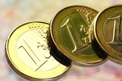 Euro coin. Euro a coin on a background of coins Stock Image