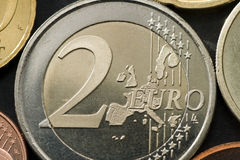Euro Coin. A two euro coin very close up on dark background Royalty Free Stock Image