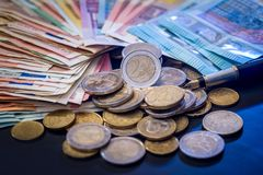 Euro coin and banknote isolated. On black background Royalty Free Stock Photos