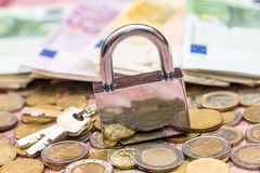 euro coin and banknote with lock Royalty Free Stock Photography