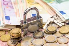 Euro coin and banknote with lock Stock Images