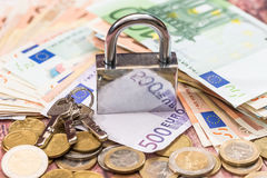 euro coin and banknote with lock. Royalty Free Stock Photography