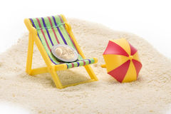 Euro coin in the beach chair Royalty Free Stock Photography