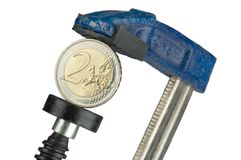 Euro-coin in clamp Royalty Free Stock Photo