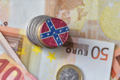 Euro coin with confederate navy jack flag on the euro money banknotes background. Finance concept Stock Photography