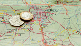 Euro coin and Cyprus cents on a map Royalty Free Stock Photography