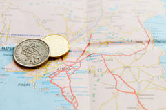 Euro coin and Cyprus cents on a map Royalty Free Stock Photos