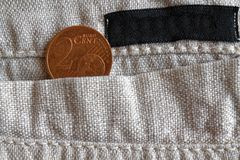 Euro coin with a denomination of two euro cents in the pocket of linen pants with black stripe Royalty Free Stock Photos