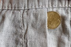 Euro coin with a denomination of 10 euro cents in the pocket of old linen pants Royalty Free Stock Images