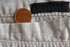 Euro coin with a denomination of one euro cent in the pocket of linen pants with black stripe. Euro coin with a denomination of 1 euro cent in the pocket of Stock Photography