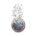 Euro coin dissolving as a concept of economic crysis Stock Image