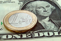 Euro Coin And Dollar Bank Note Stock Images