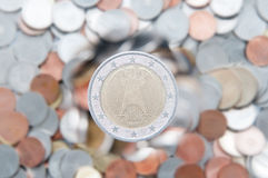Euro coin. With an eagle draw next on a pile of coins background stock photography