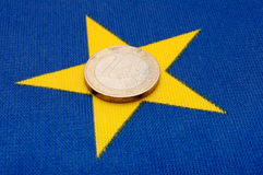 Euro Coin on EU Flag Royalty Free Stock Photo