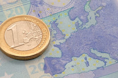Euro coin on euro banknote. Close up of euro coin on euro banknote Stock Photo