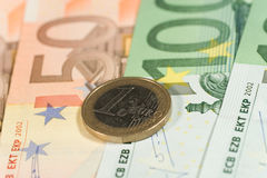 Euro coin on euro bills royalty free stock images