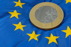 Euro coin on european flag Stock Photo