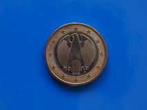 1 euro coin, European Union, Germany over blue. 1 euro coin money EUR, currency of European Union, Germany over blue background royalty free stock photos