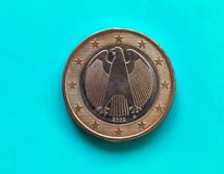 1 euro coin, European Union, Germany over green blue. 1 euro coin money (EUR), currency of European Union, Germany over green blue background royalty free stock image