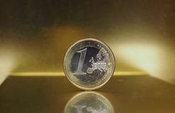 1 euro coin, European Union over gold background Royalty Free Stock Images