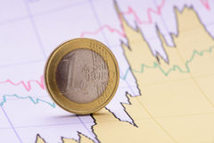 Euro coin on finance chart Stock Photos