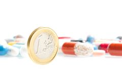 Euro coin in front of medical pills Stock Photos