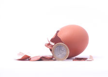 1 euro coin getting out of cracked hatched egg. Royalty Free Stock Photography