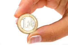 Euro coin in hand Stock Image