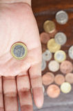 Euro coin on hand Stock Photography