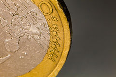 Euro coin macro, one euro. Close-up photography and details of one euro coin. Image taken with a macro professional lens. Gray background Stock Photography