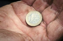 Euro coin on a man's palm Stock Photo