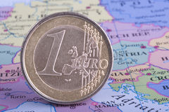 Euro Coin on Map. Old, battered Euro Coin on European Map Royalty Free Stock Images