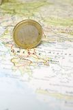 Euro Coin on a Map of Greece. One Euro coin on a map of Greece royalty free stock photo