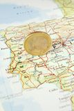 Euro Coin on a Map of Portugal Royalty Free Stock Images