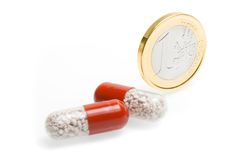Euro coin and medical pills Stock Photo