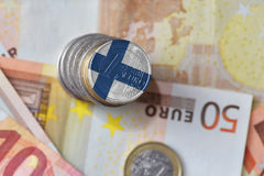 Euro coin with national flag of finland on the euro money banknotes background. Stock Photo