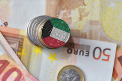 Euro coin with national flag of kuwait on the euro money banknotes background. Royalty Free Stock Photos