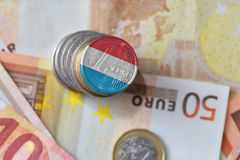 Euro coin with national flag of luxembourg on the euro money banknotes background. Finance concept Stock Images
