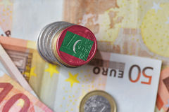 Euro coin with national flag of maldives on the euro money banknotes background. Royalty Free Stock Photography