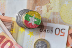 Euro coin with national flag of myanmar on the euro money banknotes background. Royalty Free Stock Photo