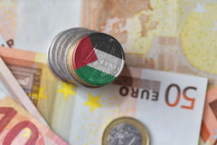 Euro coin with national flag of palestine on the euro money banknotes background. Royalty Free Stock Photography