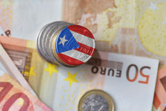 Euro coin with national flag of puerto rico on the euro money banknotes background. Stock Photos