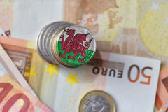 Euro coin with national flag of wales on the euro money banknotes background Stock Image