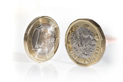 Euro coin with new design pound coin. European currency unit, the euro with the british sterling pound coin, new design Royalty Free Stock Photos