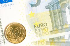 Euro coin on new five euro banknote Stock Photos